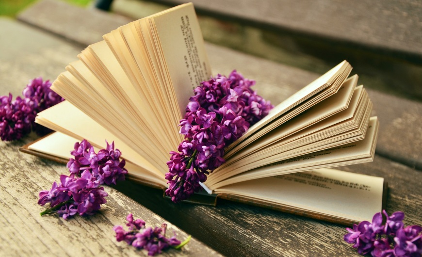 Flowers on book - The Cabal Magazine